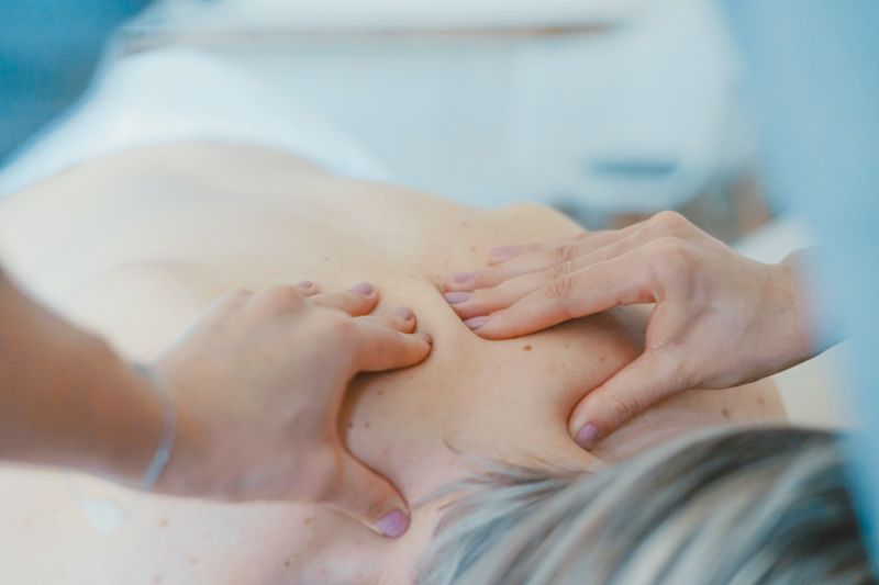 Person lying down receiving a back massage